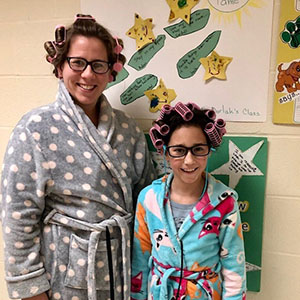 woman and girl dressed in bathrobe and curlers
