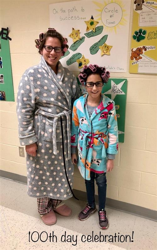 woman and girl in robe and curlers