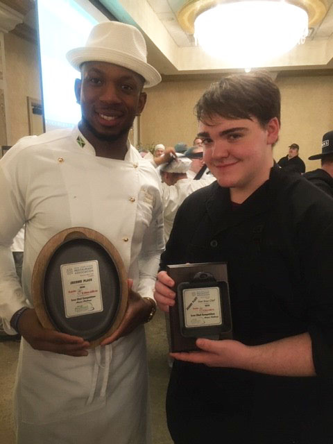 male chef posing with male student and award