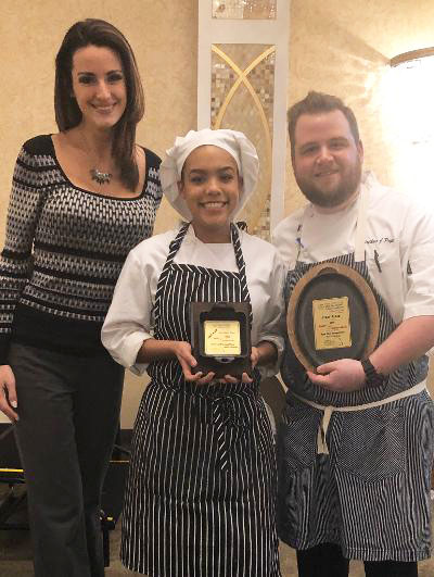 woman and female chef and male chef posing with award