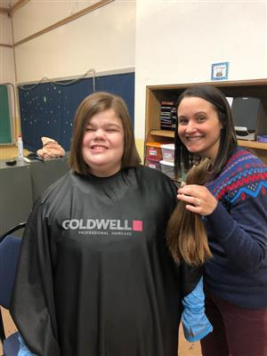 Lilly after haircut with school counselor