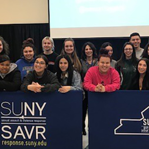 students standing at barrier