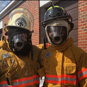 students dressed in firefighting gear
