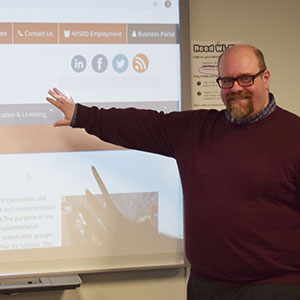 man pointing to smart board