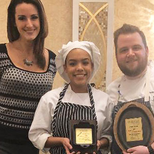 Woman, female chef and male chef holding award