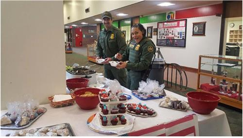 Border Patrol officers serving themselves lunch