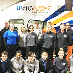 Students in front of Mercy Flight Helicopter