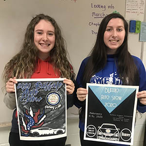 two girls holding posters