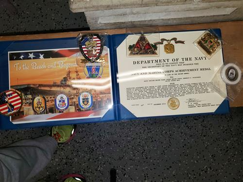 Achievement certificate and medal